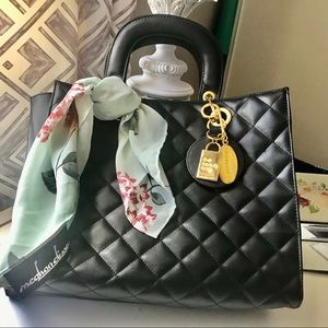 SOLD Bloomingdale's quilted faux leather handbag